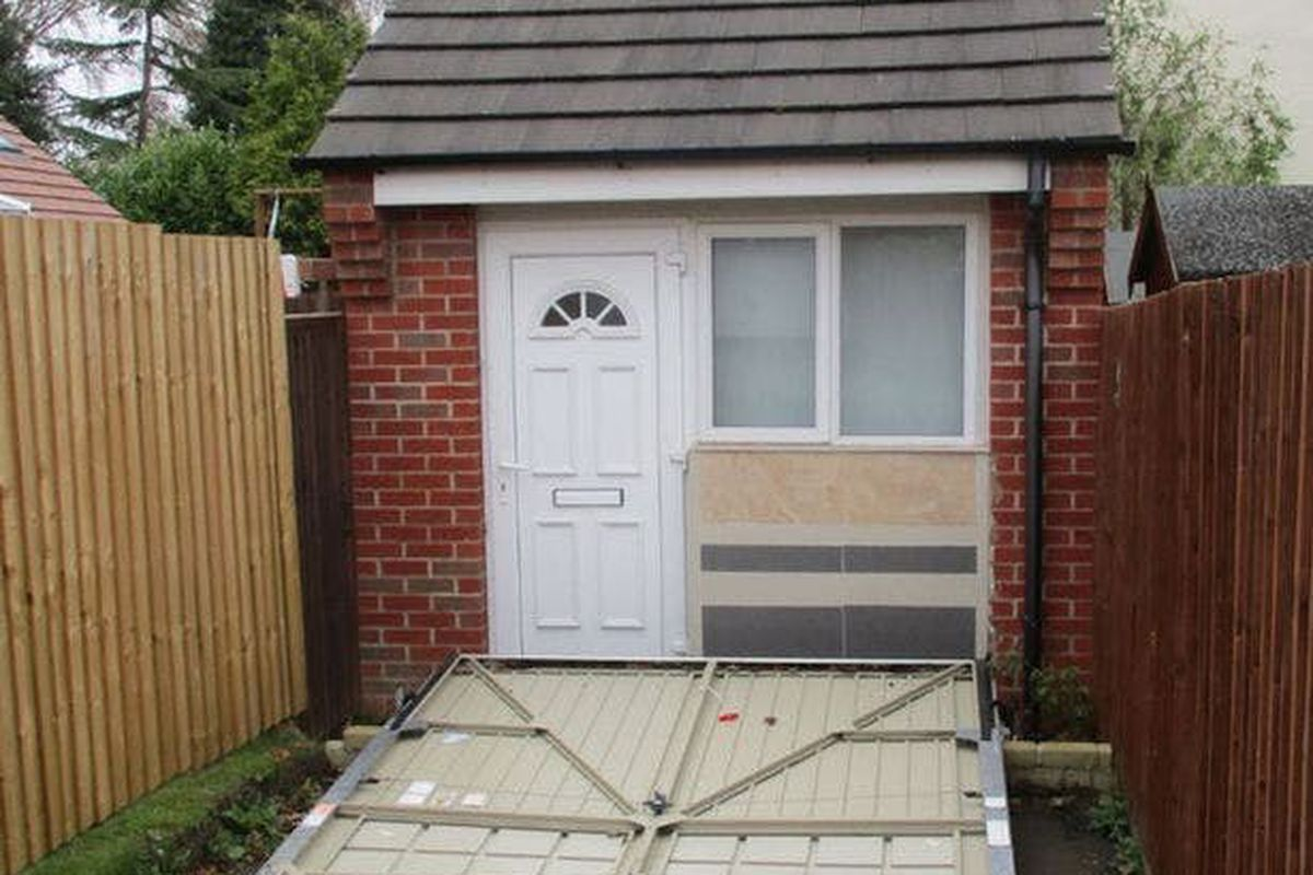 U k couple used a fake garage door to hide illegal tiny for Garage doors uk