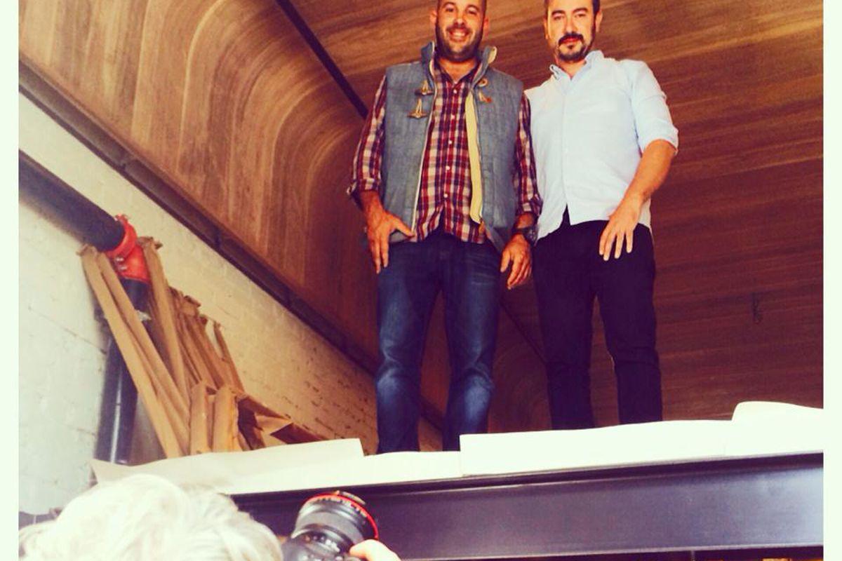 Lea co-owner Jean-François Corriveau and designer Zébulon Perron pose for a photographer