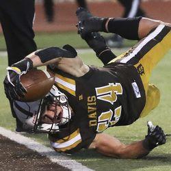 Davis running back Spencer Ferguson dives and scores a touchdown against Weber in Kaysville on Friday, Oct. 2, 2020.