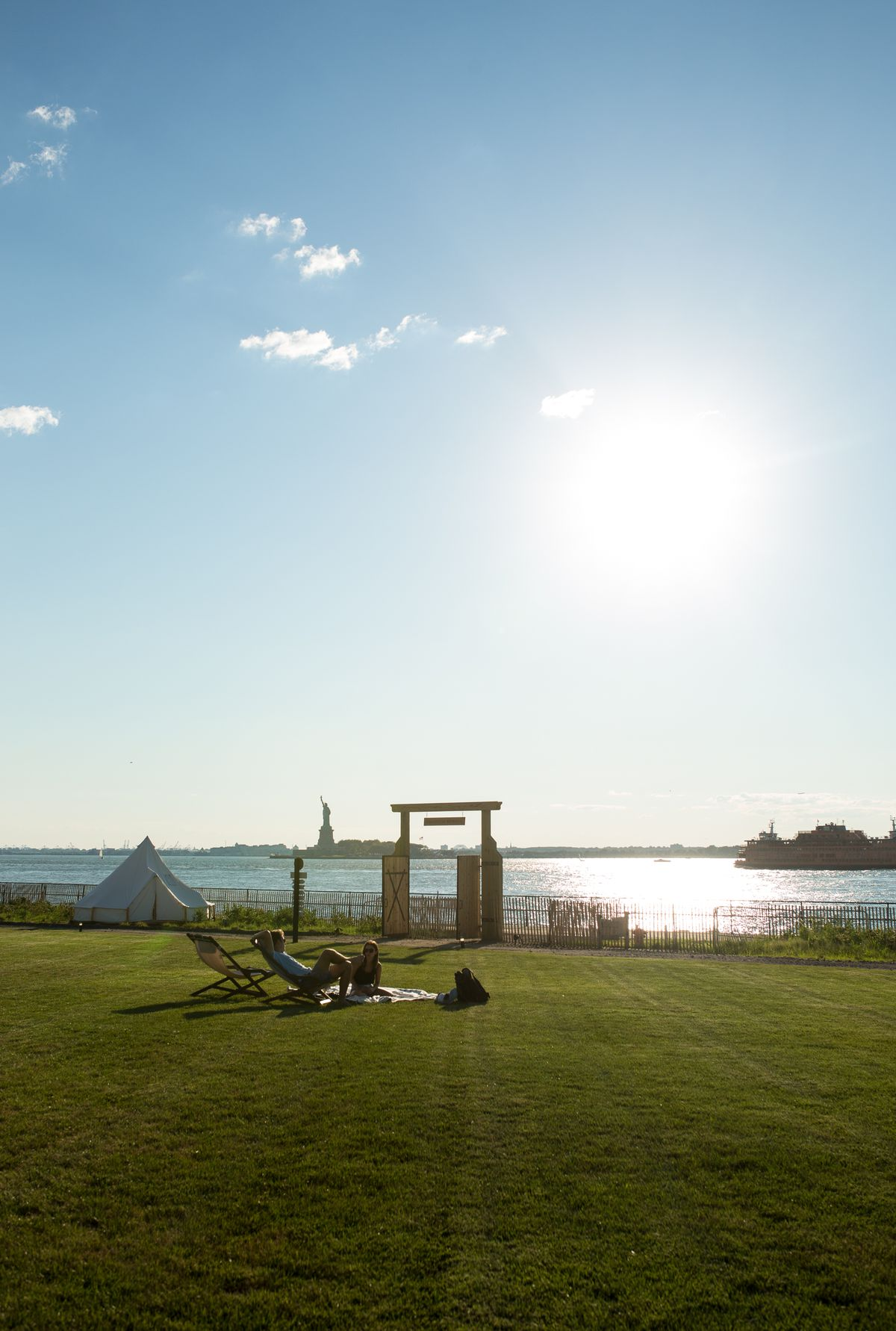 View of glamping site on with Statue of Liberty in the background