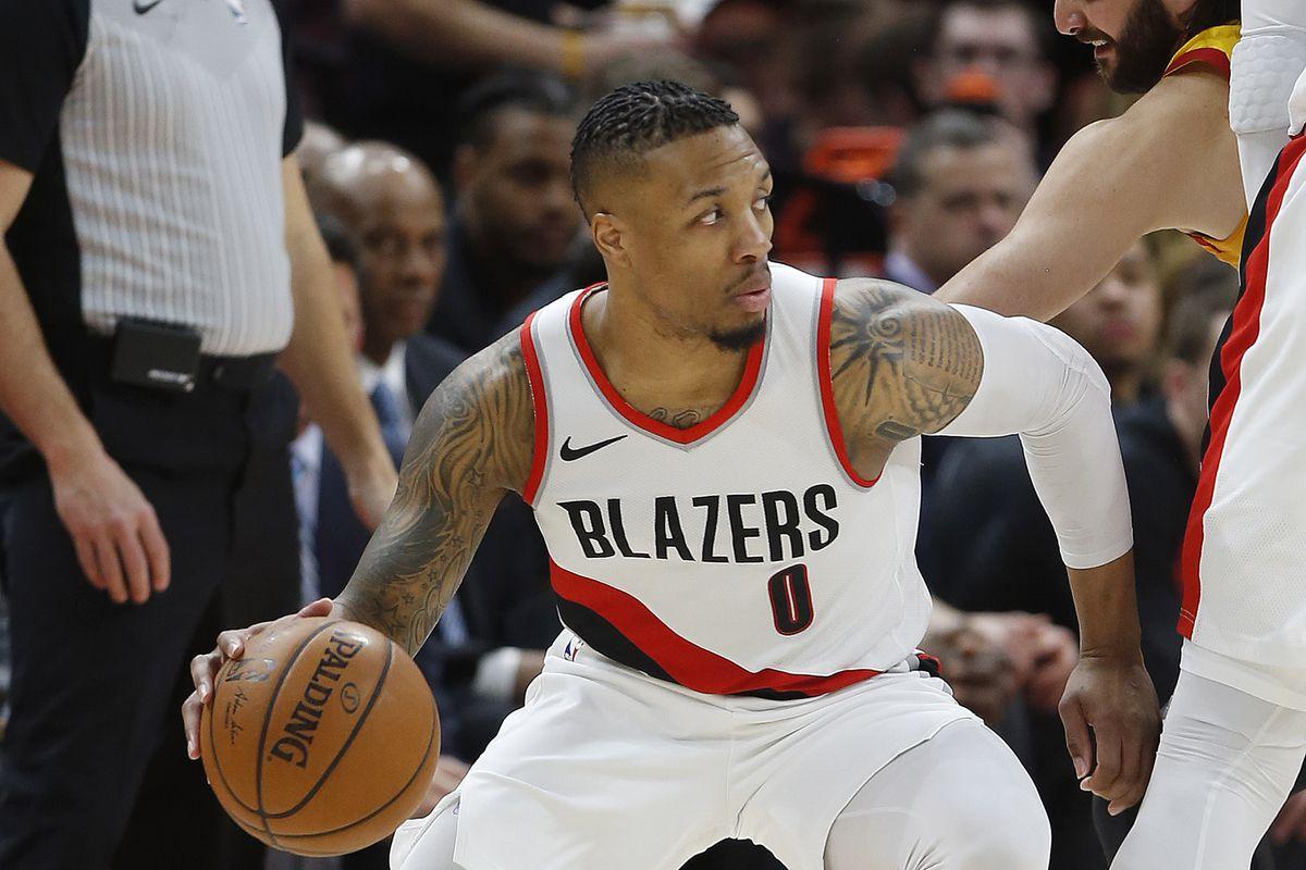 Portland Trail Blazers guard Damian Lillard (0) drives on the Jazz in Salt Lake City on Friday, Feb. 23, 2018. Portland won 100-81.
