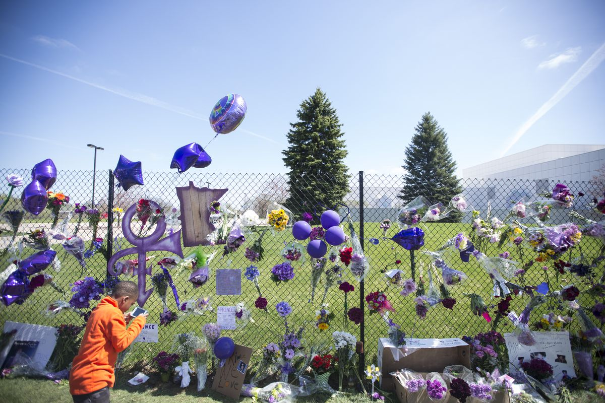 A memorial for Prince is set up on the fence outside his home at Paisley Park Friday in Chanhassen, Minn., outside Minneapolis. Renee Jones Schneider/Star Tribune via AP