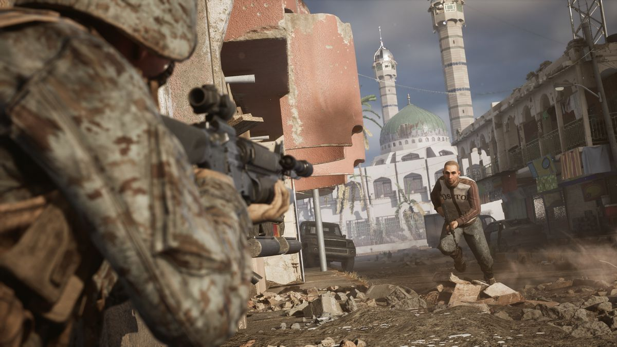 a screenshot from Six Days in Fallujah: An armed man runs through the streets of virtual Fallujah. In the foreground, a Marine takes aim. In the background, the minarets of a beautiful mosque.