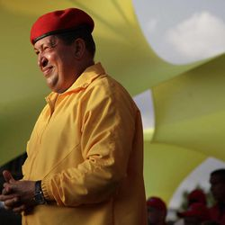 FILE - In this July 14, 2012 file photo, Venezuela's President Hugo Chavez smiles at a campaign rally in Barquisimeto, Venezuela. When he takes the stage at campaign rallies, Chavez stands alone. Under Venezuela's election system, presidential hopefuls don't choose running mates. The lack of a No. 2 leaves voters with a big unknown ahead of next month's presidential election and raises question about who in fact would take over were Chavez to win and leave office prematurely.