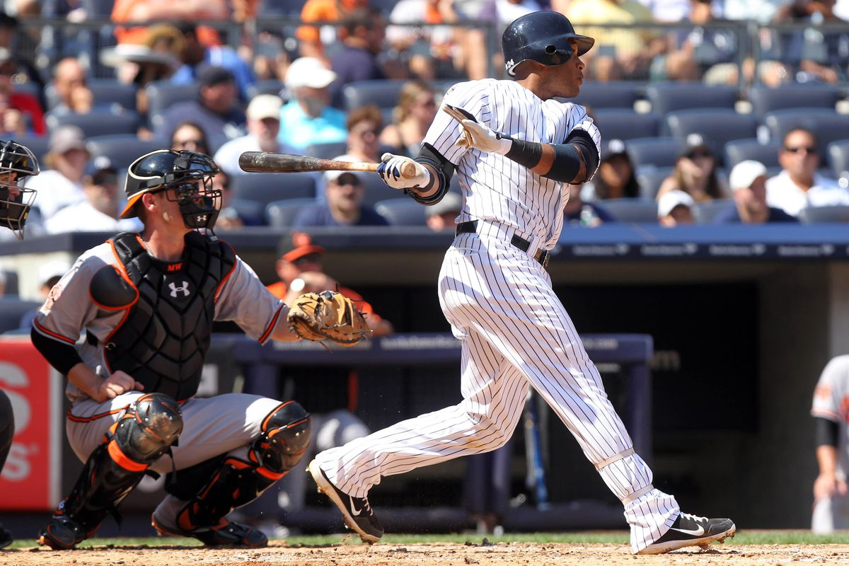 September 1, 2012; Bronx, NY, USA; New York Yankees second baseman Robinson Cano (24) hits a home run during the fourth inning of a game against the Baltimore Orioles at Yankee Stadium. Mandatory Credit: Brad Penner-US PRESSWIRE