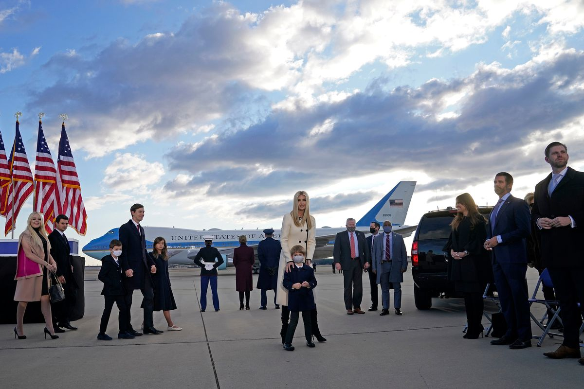 Trump family members stand on the tarmac at Joint Base Andrews in Maryland as they arrive for US President Donald Trump's departure on January 20, 2021.
