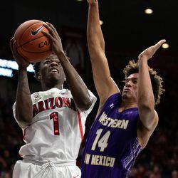 Arizona's Devonaire Doutrive (1) knocks into Western New Mexico's CJ Vanbeekum (14) during the Arizona-Western New Mexico University game in McKale Center on October 30 2018 in Tucson, Ariz.