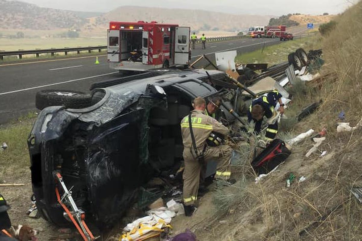 A car crash near Echo, Utah, is pictured with multiple vehicles on their side and first responders on scene.