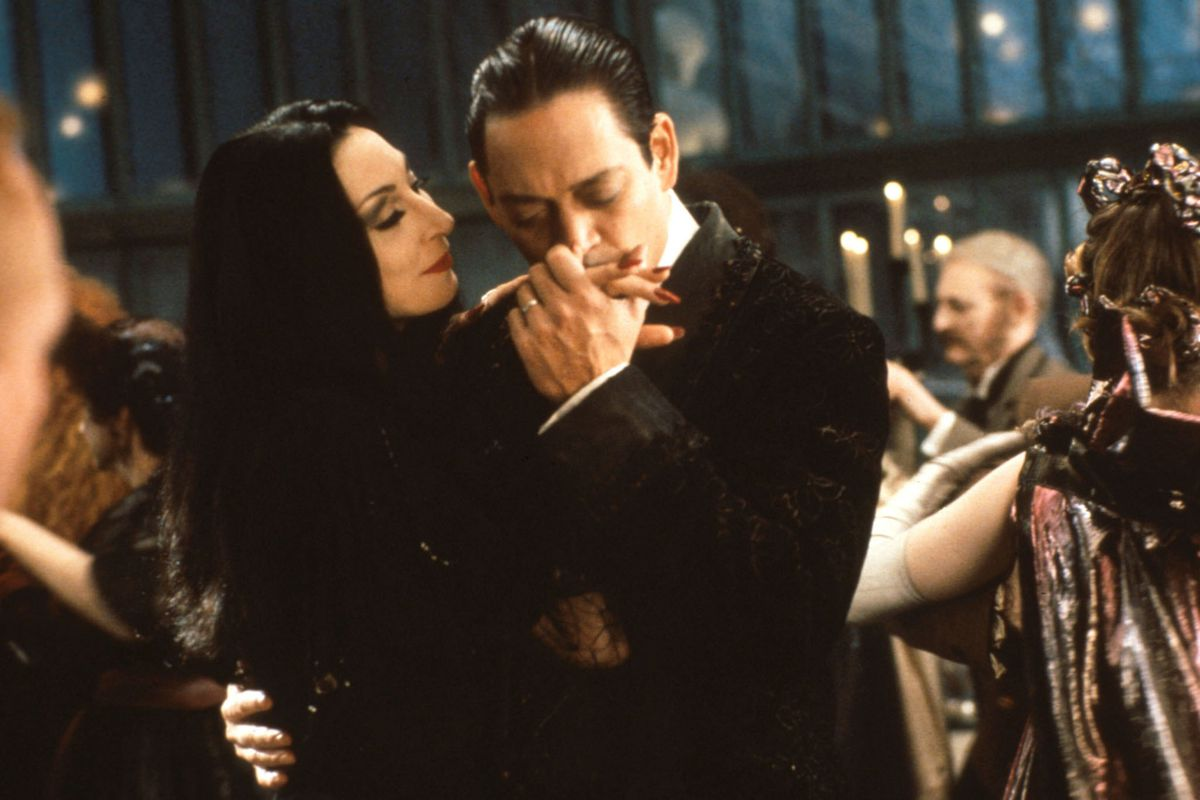 anjelica huston and raul julia in the addams family