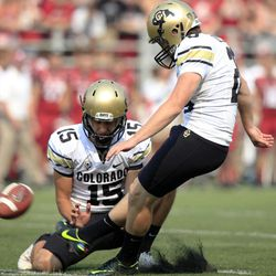 Colorado kicker Will Oliver (28) misses a field-goal attempt from the hold of Zach Grossnickle (15) during the first half of an NCAA college football game against Washington State, Saturday, Sept. 22, 2012, at Martin Stadium in Pullman, Wash.