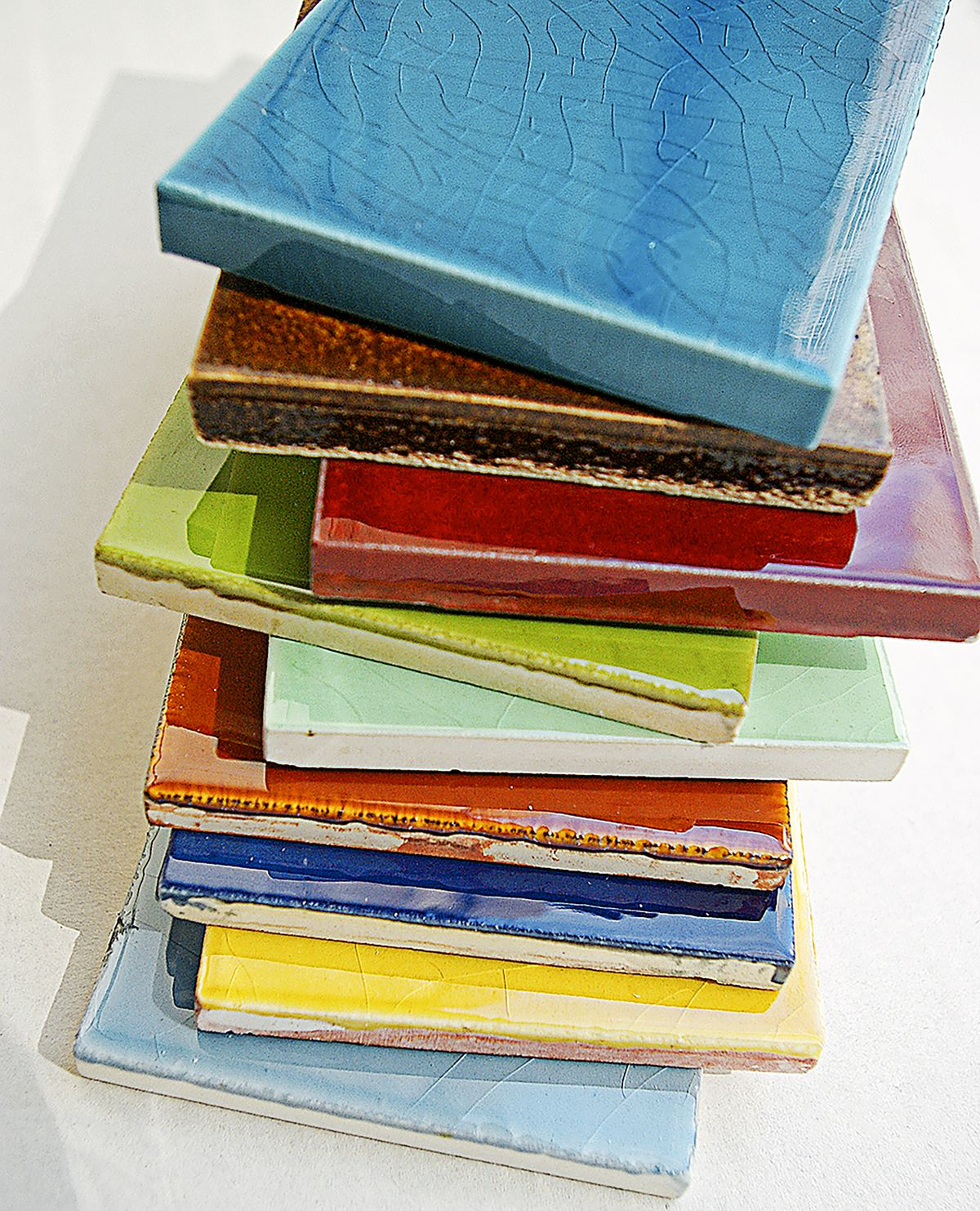 A Stack Of Ceramic Subway Tiles in Many Colors.