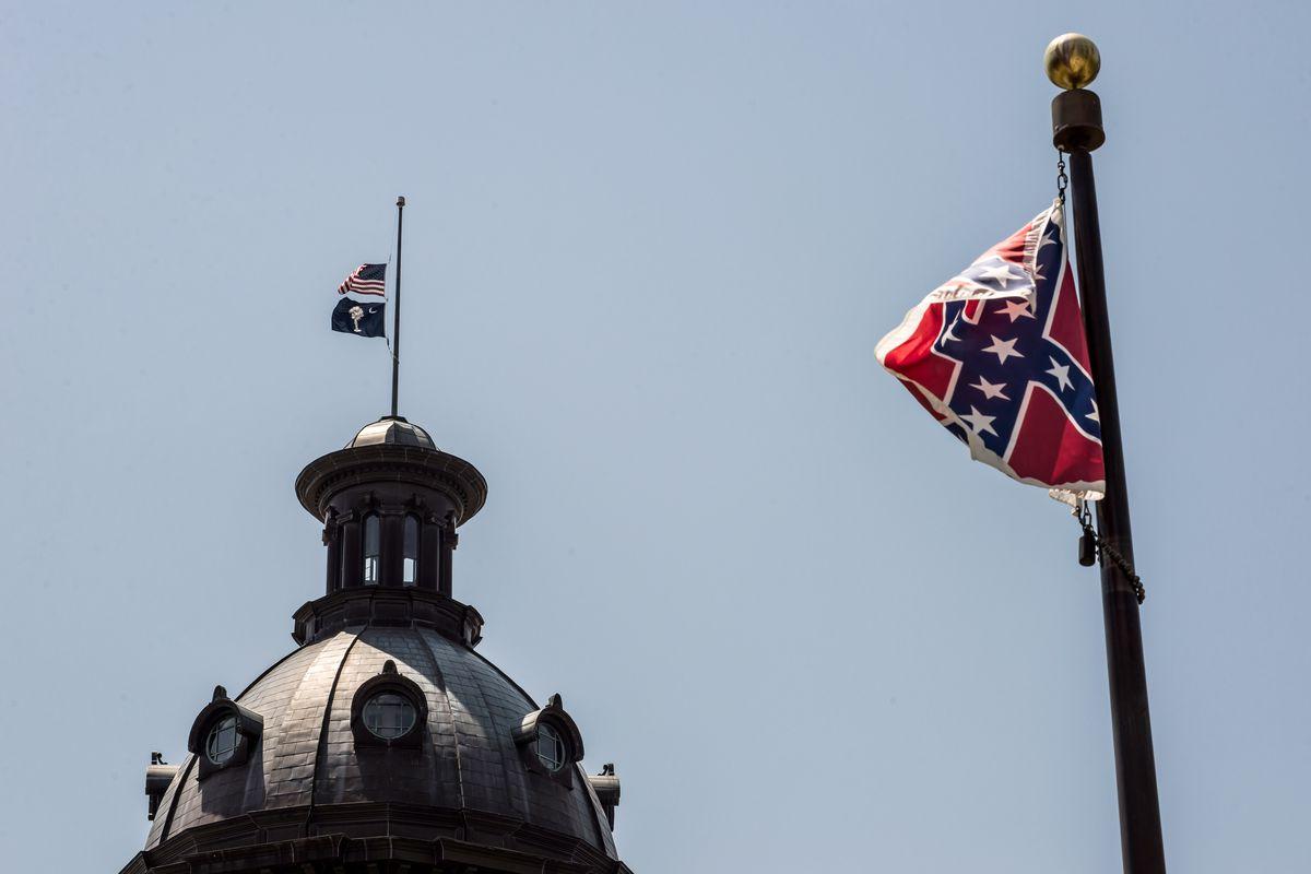 The Confederate flag flies at full mast on the South Carolina state capitol grounds on June 18. The flags atop the Capitol are at half-mast.