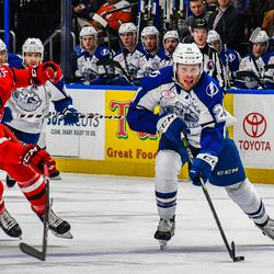 Syracuse Crunch Carter Verhaeghe (21) skating with the puck against Charlotte Checkers Clark Bishop (11) in American Hockey League (AHL) action at the War Memorial Arena in Syracuse, New York on Saturday, October 27, 2018. Charlotte won 6-3.