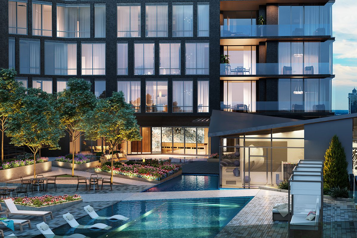 A pool with the glass building beyond.
