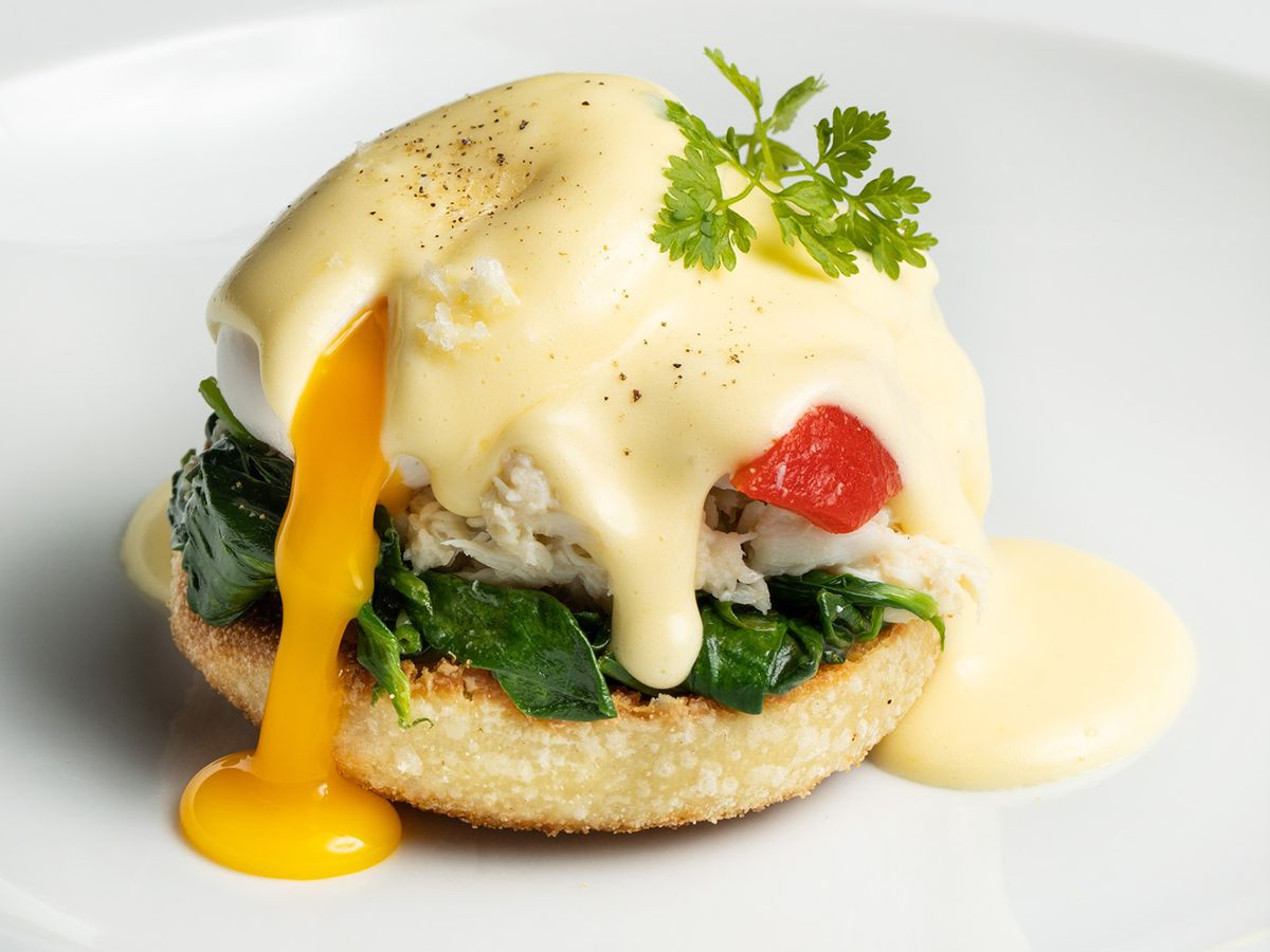 Bénédicte au crabe with jumbo lump crab with Bouchon Bakery English muffin, two poached eggs, roasted mushrooms, English peas, and sauce Hollandaise at Bouchon Bakery.