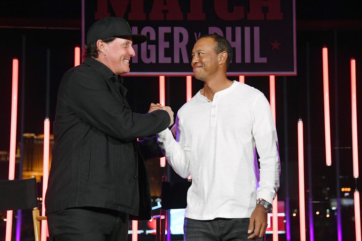 Phil Mickelson and Tiger Woods greet each other at The Match: Tiger vs Phil VIP after party at Topgolf Las Vegas on November 23, 2018 in Las Vegas, Nevada.
