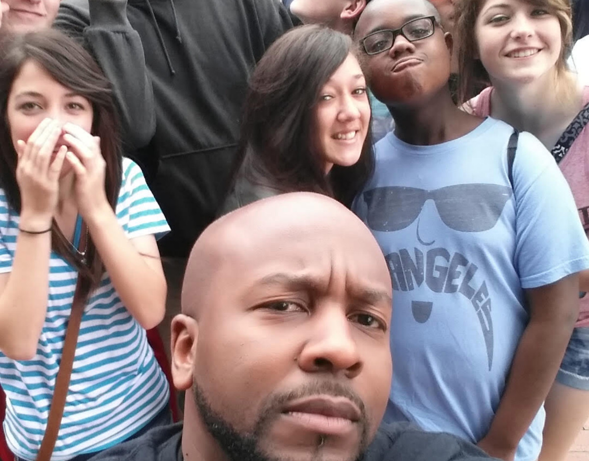 Loren Smith takes a selfie with some of his students.