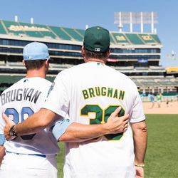 Oakland A's centerfielder Jaycob Brugman with his father Jayson Brugman on the field during a series over Father's Day weekend last June.