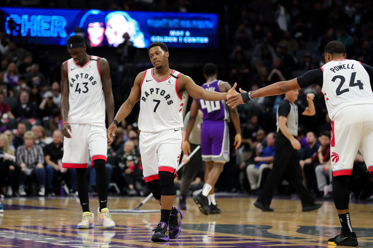 Toronto Raptors guard Kyle Lowry shakes hands with guard Norman Powell during the third quarter against the Sacramento Kings at Golden 1 Center.
