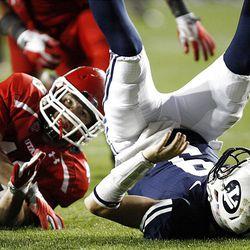 Utah Utes linebacker Trevor Reilly (49) sacks Brigham Young Cougars quarterback Jake Heaps (9)as BYU and Utah play Saturday, Sept. 17, 2011.