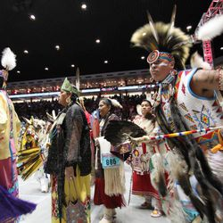 Hundreds of Native American and indigenous dancers pour onto the floor at University of New Mexico Arena for the grand entry during the 29th Annual Gathering of Nations in Albuquerque, N.M., on Friday, April 27, 2012. The event draws more than 3,000 dancers and singers and tens of thousands of spectators for three days of competitions and the crowning of Miss Indian World.