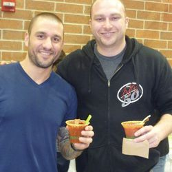 """Greg Mohr and Scott Weiner of the 50/50 with """"The Wobble Stopper"""" a Bloody Mary garnished with bacon"""