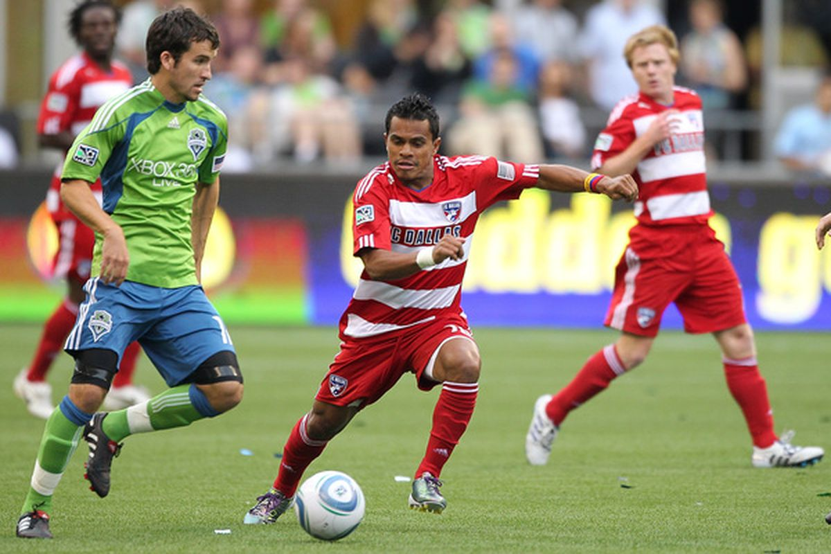 SEATTLE - JULY 11:  David Ferreira #10 of FC Dallas battles Nathan Sturgis #12 of the Seattle Sounders FC on July 11 2010 at Qwest Field in Seattle Washington. (Photo by Otto Greule Jr/Getty Images)