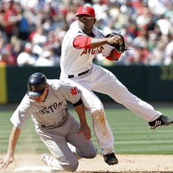 Howie Kendrick, right, of the Los Angeles Angels starts a double play as Boston Red Sox's Jacoby Ellsbury is out at second base during a game earlier this season. Kendrick is currently with the Bees while trying to work his way out of a batting slump.