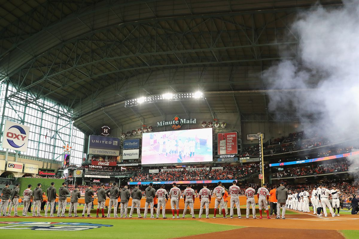 A general view as the Boston Red Sox and the Houston Astros stand for the national anthem before Game Three of the American League Championship Series at Minute Maid Park on October 16, 2018 in Houston, Texas.