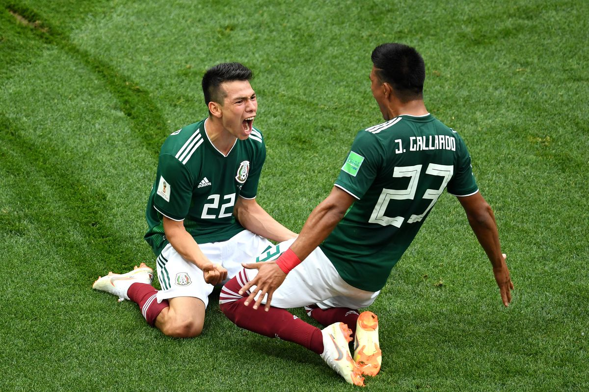 38be600f556 Hirving Lozano of Mexico celebrates with Jesus Gallardo by sliding on their  knees after scoring his team s first goal during the 2018 FIFA World Cup  Russia ...
