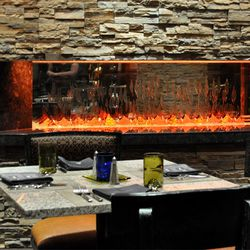 The fireplace shared by the dining room and the private dining room.
