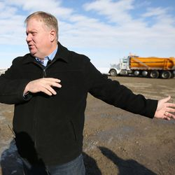 Jim Russell, assistant director of the Utah Division of Facilities Construction & Management, discusses construction of the new prison as crews build a temporary road to access the site, seen  behind him, in Salt Lake City on Wednesday, Dec. 28, 2016.