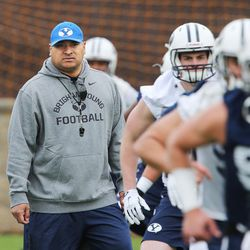 Brigham Young Cougars head coach Kalani Sitake watches players during practice in Provo Tuesday, March 1, 2016.