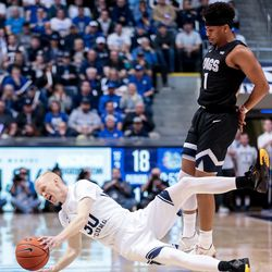 Brigham Young Cougars guard TJ Haws (30) hits the boards on a foul by Gonzaga Bulldogs guard Admon Gilder (1) at the Marriott Center in Provo on Saturday, Feb. 22, 2020.