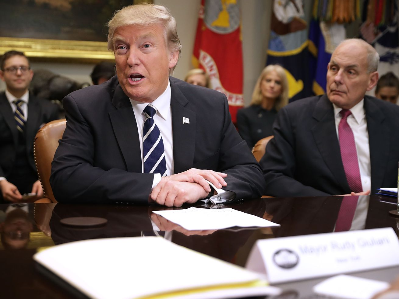 Outgoing Chief of Staff John Kelly, then homeland security secretary, sits next to President Donald Trump in a meeting in the White House in January 2017.
