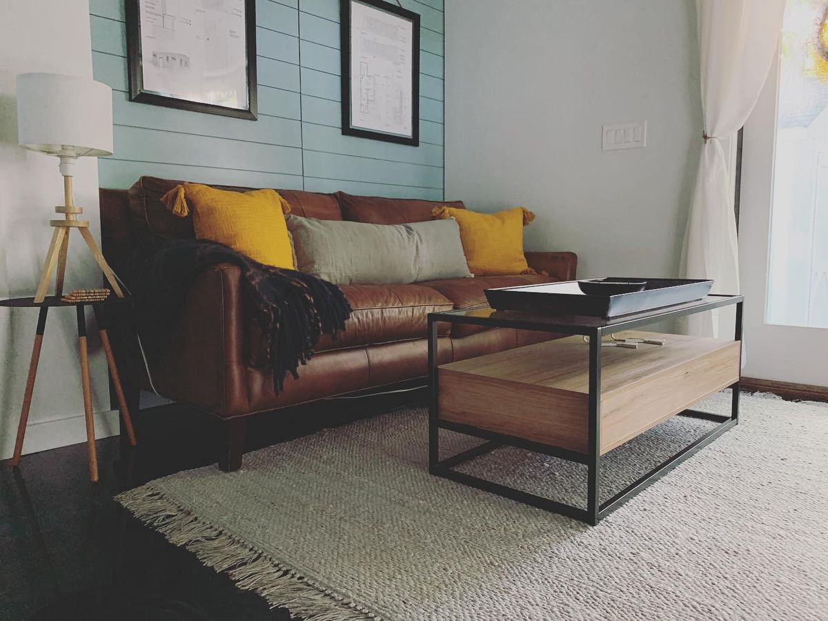 A little leather couch and coffee table.