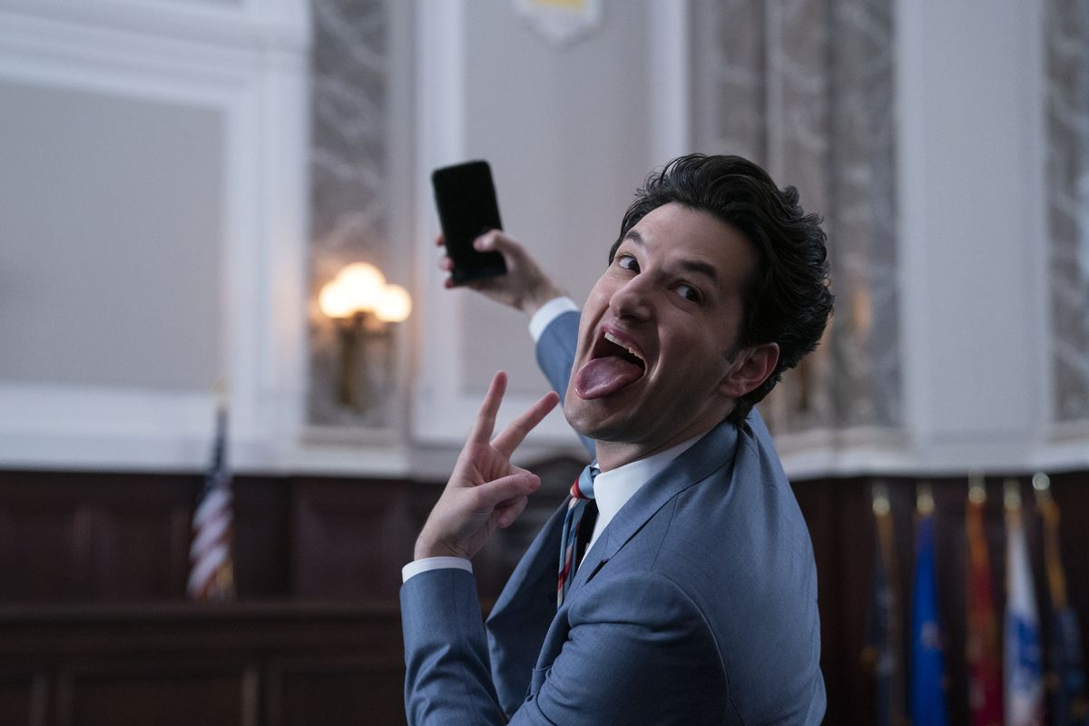 F. Tony (Ben Schwartz) takes a selfie while throwing a peace sign and sticking out his tongue