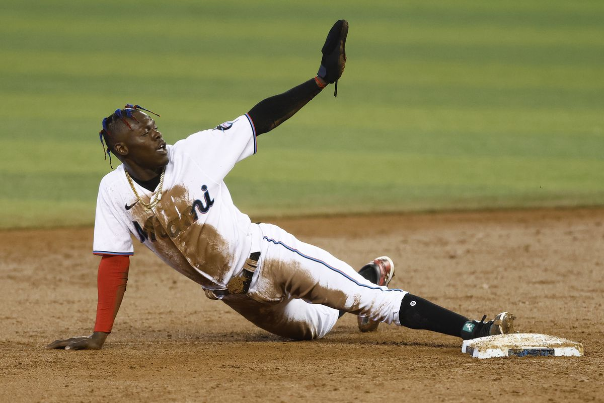 Jazz Chisholm Jr. #2 of the Miami Marlins reacts after safely stealing second base during the first inning at loanDepot Park on April 21, 2021 in Miami, Florida.