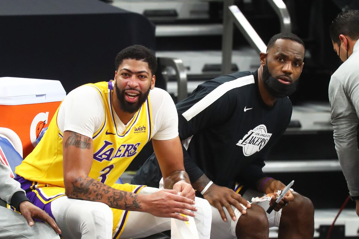 Los Angeles Lakers forward LeBron James and forward Anthony Davis against the Phoenix Suns during a preseason game at Phoenix Suns Arena.
