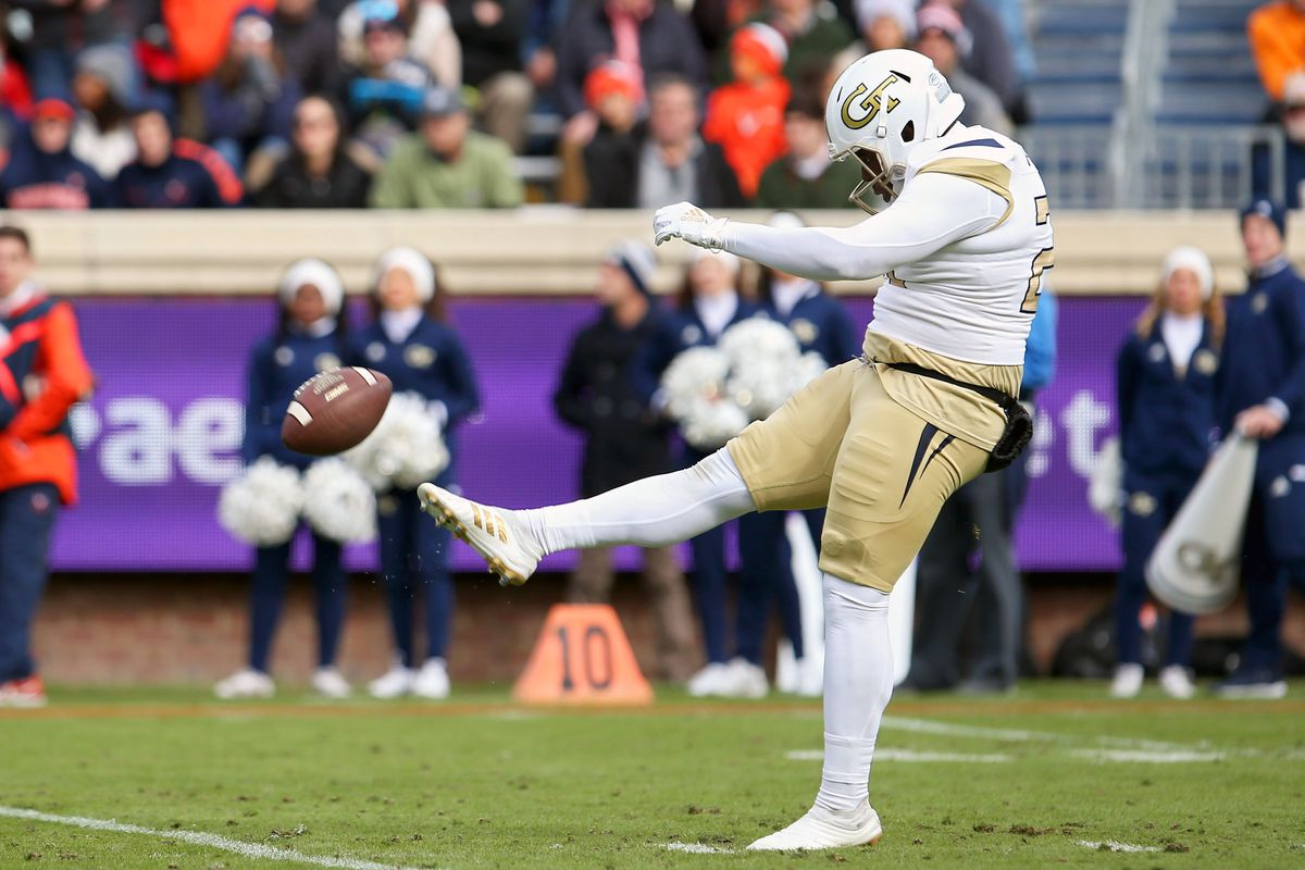 Pressley Harvin III #27 of the Georgia Tech Yellow Jackets punts in the first half during a game against the Virginia Cavaliers at Scott Stadium on November 9, 2019 in Charlottesville, Virginia.