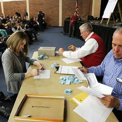 Amelia Blanchard, left, David McMillan and Frank Christianson count votes for state delegates during a Utah Republican caucus at Brighton High School in Salt Lake City on Tuesday, March 22, 2016.