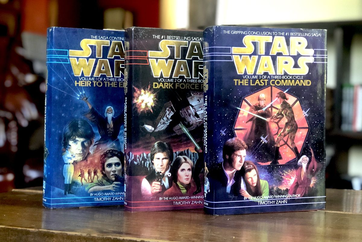 The three books of Timothy Zahn's Thrawn Trilogy stand on a wooden table.