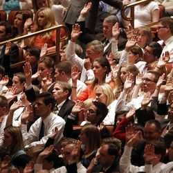 Members of the audience sustain church leaders during the 182nd Annual General Conference for The Church of Jesus Christ of Latter-day Saints at the LDS Conference Center in Salt Lake City on Saturday, March 31, 2012.