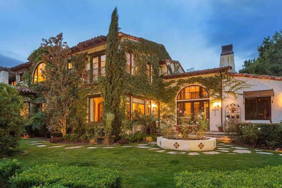 An ivy-covered Spanish-style mansion.