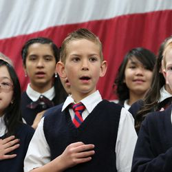 """Children from the school choir sing """"The Star Spangled Banner"""" as they join GOP presidential candidate and Texas Sen. Ted Cruz, former candidate Carly Fiornia, talk show host Glenn Beck and Sen. Mike Lee, R-Utah, at a rally in Draper at the American Preparatory Academy Saturday, March 19, 2016."""