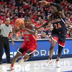 Justin Coleman (12) looks to score past Emmanuel Akot (24) during the 2018 Red-Blue game in McKale Center on October 14 in Tucson, Ariz.