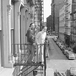 FILE - In this March 17, 1980 file photo, Stan and Julie Patz stand on the 2nd-floor fire escape of the of their loft in the Soho neighborhood of New York.  Below them runs Prince Street, along which Etan, their 6-year-old son, set off to school on May 25, 1979, and has not been seen since. On Thursday, April 19, 2012, a team of police officers and FBI agents started to begin tearing apart the basement of a building about a block from where the family lived as part of the decades-old investigation into the disappearance of the boy. Authorities have not said whatevidence led them to that location.