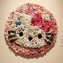 """""""Hello Kitty in Bloom"""" by Michael Courville is made up of vintage flower pins."""