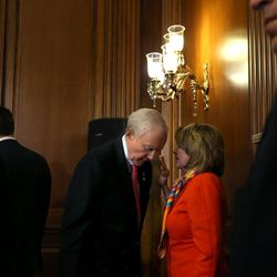 Sen. Orrin Hatch, R-Utah, president pro tem of the U.S. Senate and member and former chairman of the Senate Judiciary Committee, confers with House Democratic Leader Nancy Pelosi, D-Calif., after a a bipartisan, bicameral enrollment ceremony for the Every Student Succeeds Act (S. 1177) at the Capitol in Washington, D.C., on Wednesday, Dec. 9, 2015.