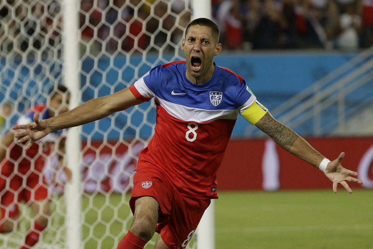 United States' Clint Dempsey celebrates after scoring the opening goal during the group G World Cup soccer match between Ghana and the United States at the Arena das Dunas in Natal, Brazil, Monday, June 16, 2014. The United States won the match 2-1. (AP P